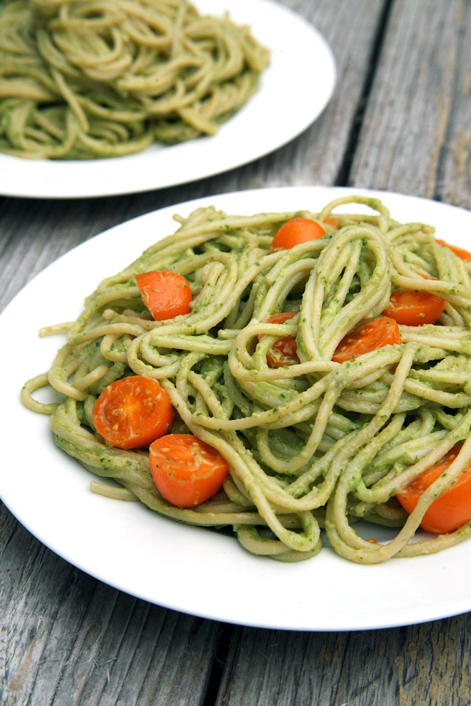 """<p>This oh-so-creamy delicious homemade dish is like a combination of mac and cheese and pesto pasta. Use fresh basil and tomatoes from your garden, and up the protein by adding <a href=""""https://www.popsugar.com/fitness/photo-gallery/34429412/image/34437125/How-Sauté"""" class=""""link rapid-noclick-resp"""" rel=""""nofollow noopener"""" target=""""_blank"""" data-ylk=""""slk:sautéed tofu"""">sautéed tofu</a>, beans, or <a href=""""https://www.popsugar.com/fitness/Beyond-Sausage-Review-44883119"""" class=""""link rapid-noclick-resp"""" rel=""""nofollow noopener"""" target=""""_blank"""" data-ylk=""""slk:Beyond Meat sausage"""">Beyond Meat sausage</a>.</p> <p><strong>Get the recipe:</strong> <a href=""""https://www.popsugar.com/fitness/Avocado-Pasta-40509917"""" class=""""link rapid-noclick-resp"""" rel=""""nofollow noopener"""" target=""""_blank"""" data-ylk=""""slk:avocado pesto pasta"""">avocado pesto pasta</a></p>"""