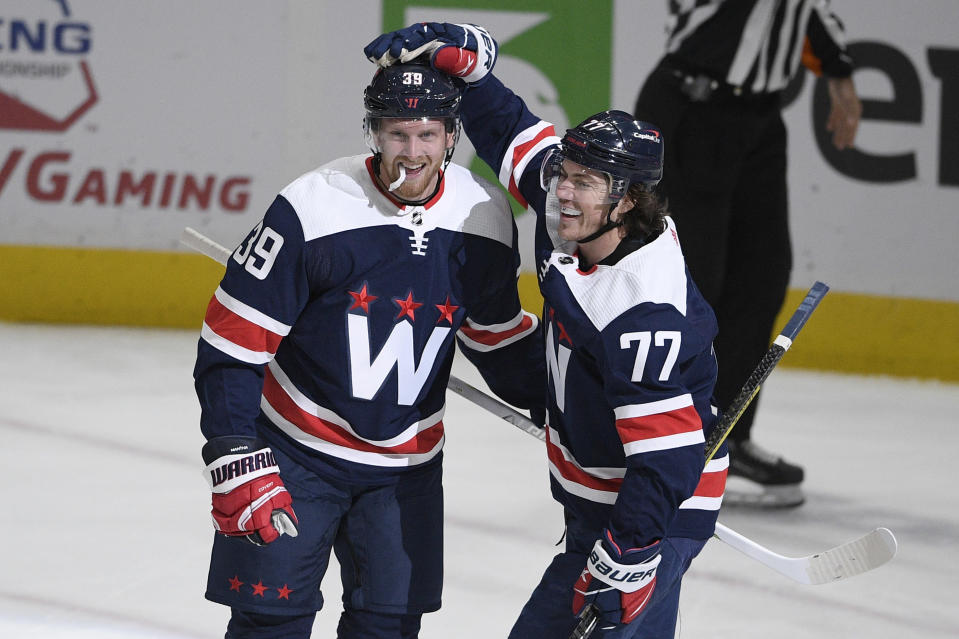 Washington Capitals right wing Anthony Mantha (39) celebrates his goal with right wing T.J. Oshie (77) during the second period of an NHL hockey game against the Buffalo Sabres, Thursday, April 15, 2021, in Washington. (AP Photo/Nick Wass)
