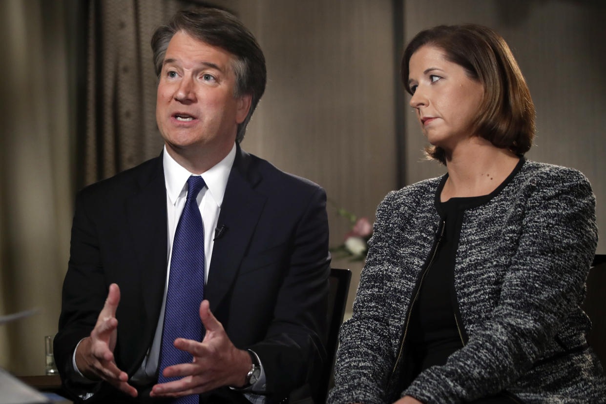 Brett Kavanaugh, with his wife, Ashley Estes Kavanaugh, answers questions during a Fox News interview about allegations of sexual misconduct. (Photo: Jacquelyn Martin/AP)