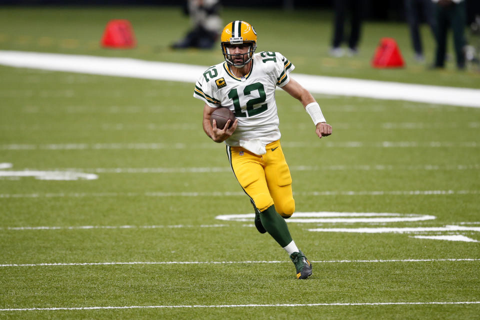 Green Bay Packers quarterback Aaron Rodgers (12) carries in the first half of an NFL football game against the New Orleans Saints in New Orleans, Sunday, Sept. 27, 2020. (AP Photo/Butch Dill)