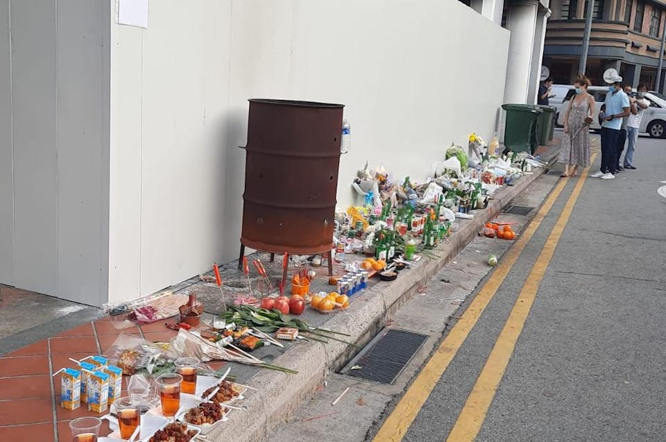 Offerings seen at the crash site along Tanjong Pagar Road on 17 February, 2021. (PHOTO: Wan Ting Koh/Yahoo News Singapore)