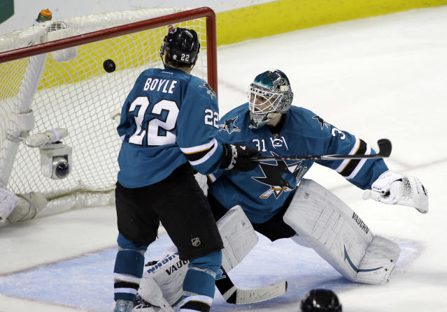 San Jose Sharks goalie Antti Niemi, of Finland, right, is beaten for a goal on as shot from Washington Capitals' Chris Brown during the third period of an NHL hockey game on Saturday, March 22, 2014, in San Jose, Calif. Washington won 3-2. (AP Photo/Marcio Jose Sanchez)