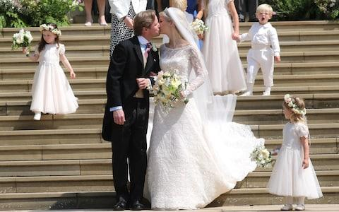 There were six bridesmaids and three pageboys - Credit: PA