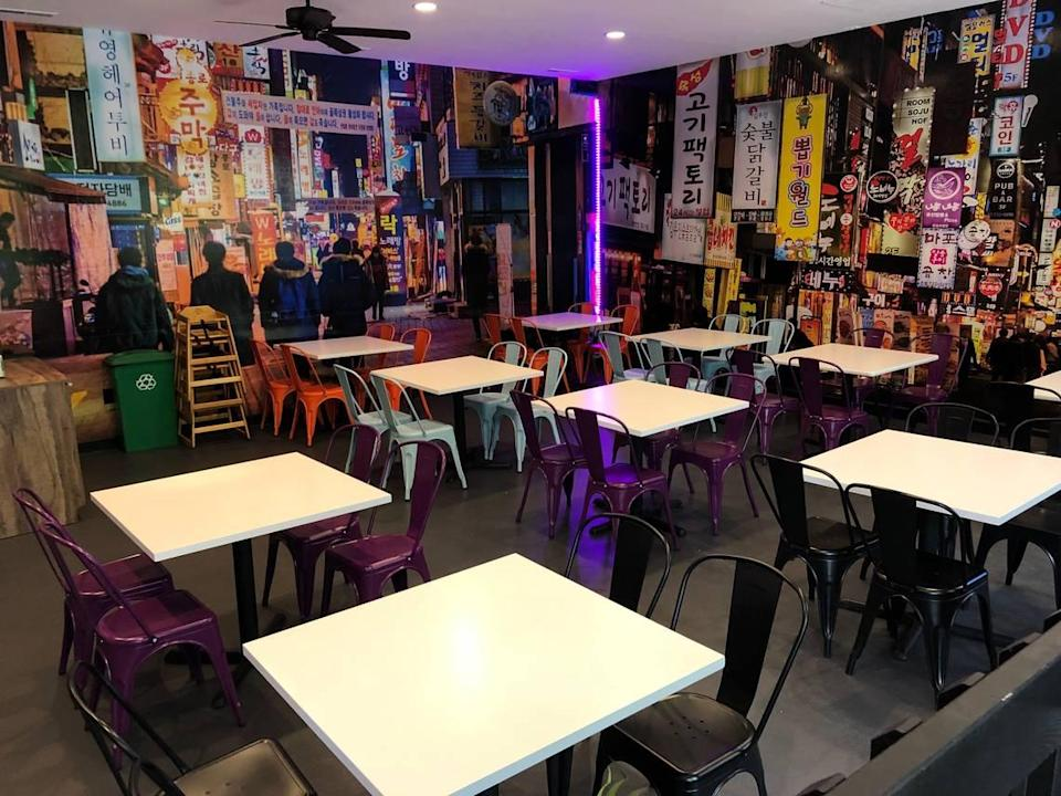 The interior of Taco Park and Ramyun Time puts diners in the streets of Seoul, South Korea.