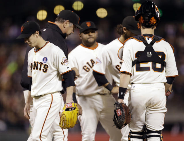 San Francisco Giants starting pitcher Tim Lincecum, left, is pulled from the game by manager Bruce Bochy, second from left, during the sixth inning of a baseball game against the Boston Red Sox on Monday, Aug. 19, 2013, in San Francisco. (AP Photo/Marcio Jose Sanchez)
