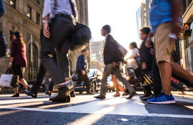 In this stock photo, pedestrians cross a busy street in downtown Toronto. Canadians have serious doubts about their financial future and the economy as a whole, a new survey from Edelman has found.