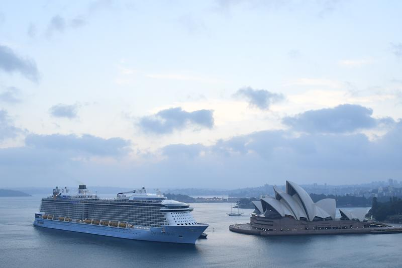 Pictured is the Ovation of the Seas vessel arriving in Sydney Harbour on Monday morning, sailing beyond the Sydney Opera House.