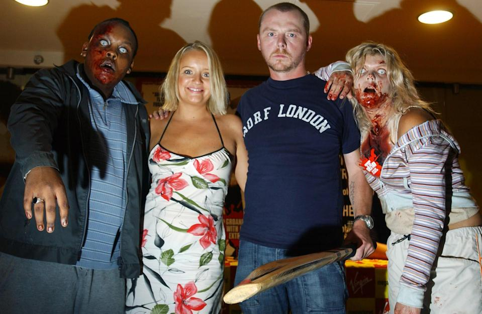 Actors Lucy Davis and Simon Pegg (centre left and right) pose alongside two 'zombies' during an in-store appearance at Virgin Megastore on Piccadilly, central London  to sign copies of the new Shaun Of The Dead DVD, which was realeased today.   (Photo by Andy Butterton - PA Images/PA Images via Getty Images)