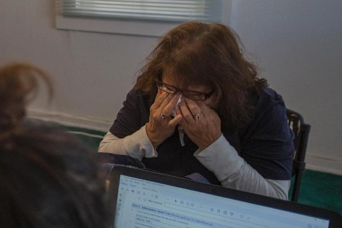 Gloria Eliza cries while applying for citizenship at the TODEC (Training Occupational Development Educating Communities) office on February 24, 2017 in Coachella, California (AFP Photo/DAVID MCNEW)