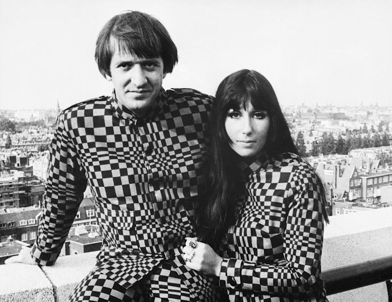 (Original Caption) 9/1966-Frankfurt, Germany- U.S. recording stars Sonny and Cher caused a stir in German fashion circles by sporting matching supermod suits (checker-board pattern), for both formal and informal wear. The husband and wife team, currently on a concert tour of Europe, continually face a problem of being refused admission to hotels and restaurants because of their unusual attire.