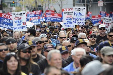Thousands gather for a march and rally by labor union supporters in Los Angeles