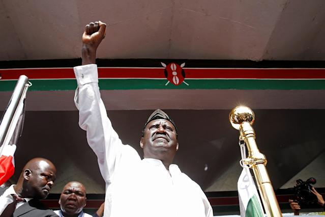 <p>Kenyan opposition leader Raila Odinga of the National Super Alliance (NASA) raises his fist before taking a symbolic presidential oath of office in Nairobi, Kenya, Jan. 30, 2018.<br> (Photo: Baz Ratner/Reuters) </p>