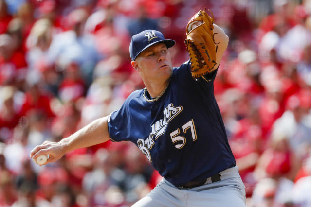 FILE - In this Sept. 26, 2019, file photo, Milwaukee Brewers starting pitcher Chase Anderson throws in the first inning of a baseball game against the Cincinnati Reds in Cincinnati. The Brewers cut $15 million in payroll for next season, trading right-hander Anderson to the Toronto Blue Jays on Monday, Nov. 4, 2019, for prospect Chad Spanberger and declining a $7.5 million option on first baseman Eric Thames. (AP Photo/John Minchillo, File)