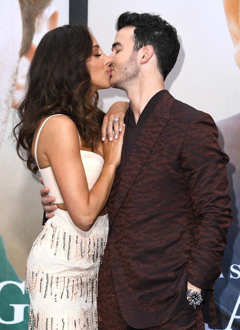 Kevin Jonas kisses his wife