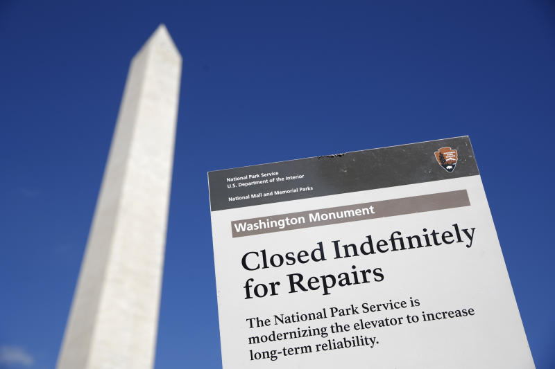 A sign greets visitors outside of the Washington Monument during a press preview tour ahead of the monument's official reopening, Wednesday, Sept. 18, 2019, in Washington. The monument, which has been closed to the public since August 2016, is scheduled to re-open Thursday, Sept. 19. (AP Photo/Patrick Semansky)