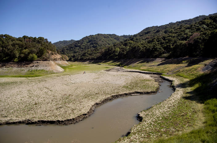 An aerial view shows drought-stricken Stevens Creek Reservoir, currently at 18% capacity, in Cupertino, Calif., Thursday, May 20, 2021. California Gov. Gavin Newsom declared a drought emergency for most of the state. (AP Photo/Josh Edelson)