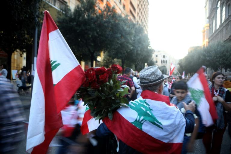 Vendors have taken to the streets to sell roses, Lebanese flags, food and water to anti-government protesters during demonstrations (AFP Photo/Patrick BAZ)