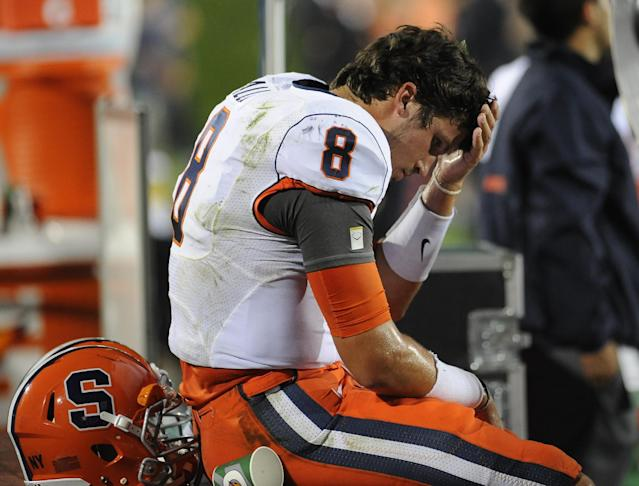 Syracuse's Drew Allen, (8), wipes his face on the sidelines after he was intercepted in the second half of an NCAA college football game against Northwestern University in Evanston, Ill, Saturday, Sept. 7, 2013 (AP Photo/Matt Marton)