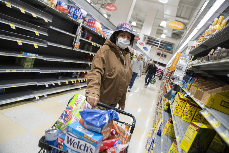 UNITED STATES - MARCH 23: A shopper wears a face mask due to the coronavirus outbreak while browsing an aisle in the Harris Teeter on First Street, NE, on Monday, March 23, 2020.(Photo By Tom Williams/CQ-Roll Call, Inc via Getty Images)