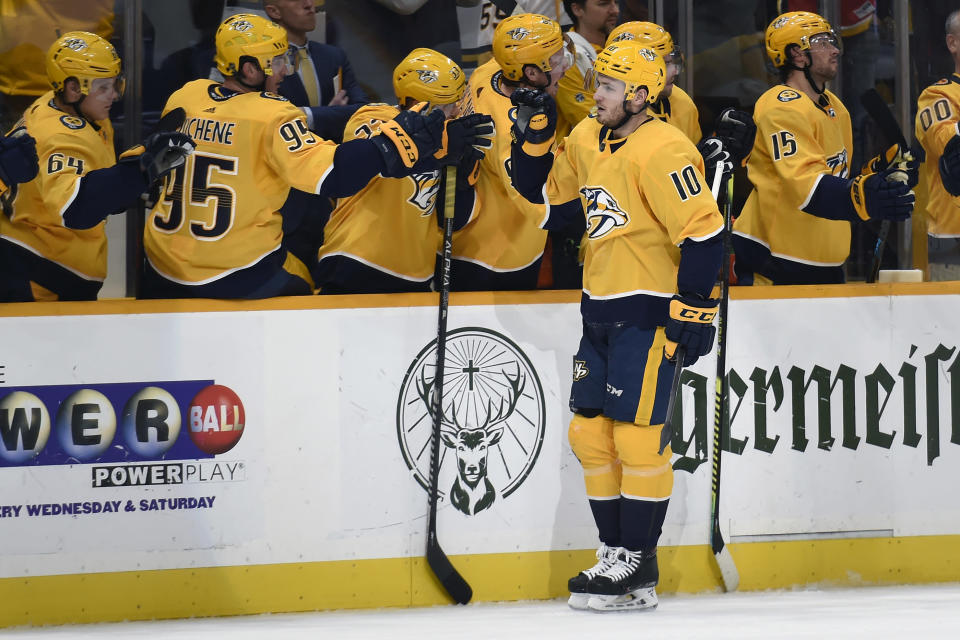 Nashville Predators center Colton Sissons (10) is congratulated after scoring against the Calgary Flames during the first period of an NHL hockey game Thursday, Feb. 27, 2020, in Nashville, Tenn. (AP Photo/Mark Zaleski)
