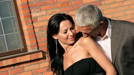 Attractive mature couple on brick background