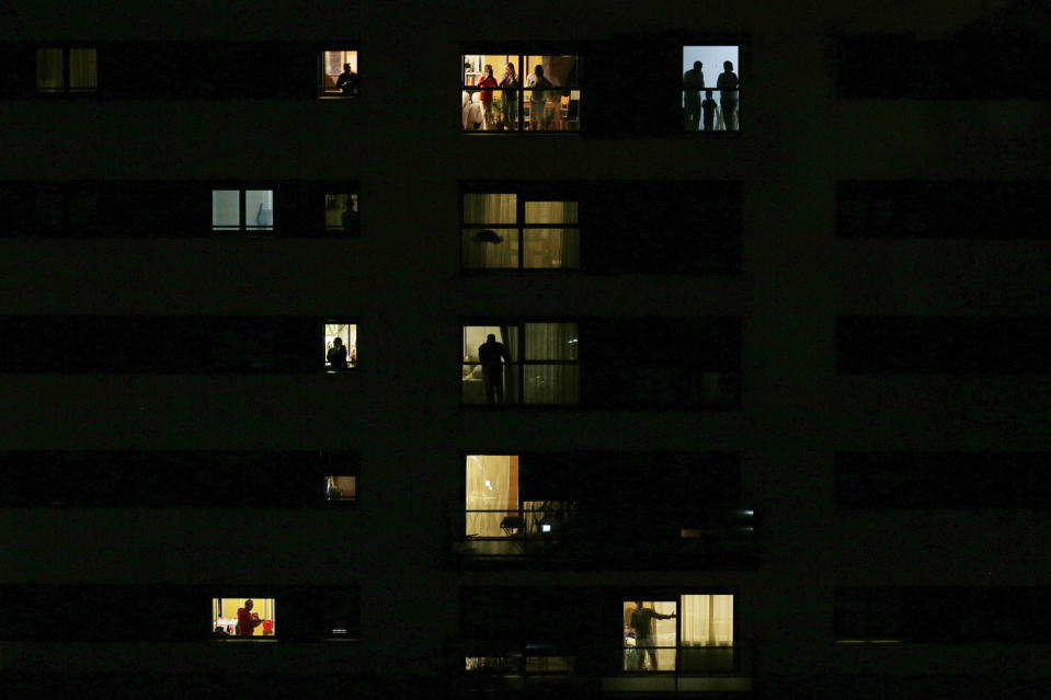 FILE - In this March 14, 2020 file photo, people applaud from their homes in support of the medical staff who are working to fight the COVID-19 pandemic in Rivas Vaciamadrid, Spain. (AP Photo/Manu Fernandez, File)