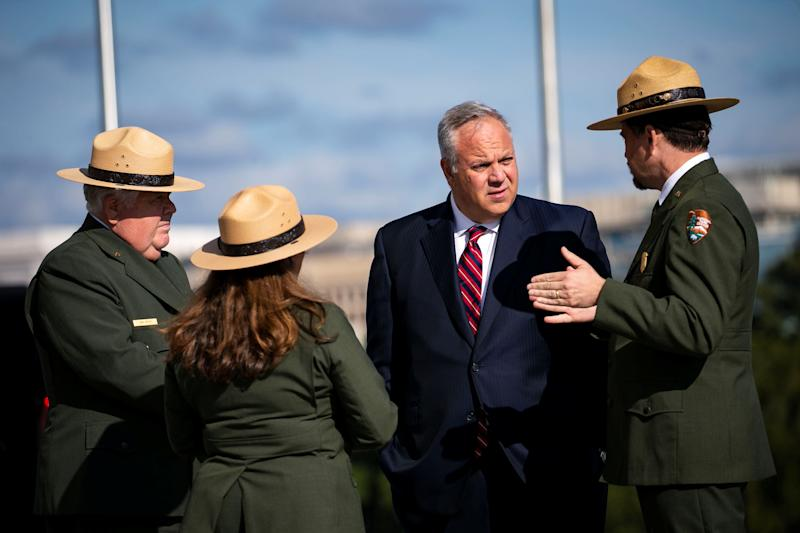 U.S. Interior Secretary David Bernhardt speaks with park rangers before first lady Melania Trump participates in a ribbon cutting and ceremonial ride to the top, to celebrate the re-opening of the Washington Monument, after a 37-month closure to modernize the elevator control system and construct a new security screening facility, in Washington, Sept. 19, 2019. (Photo: Al Drago/Reuters)