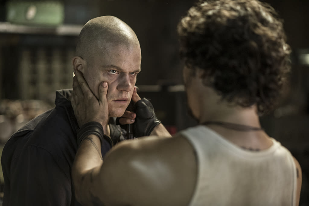 Spider (WAGNER MAURA, right) and Max (MATT DAMON, left) in Spider's Armory from TriStar Pictures' ELYSIUM.