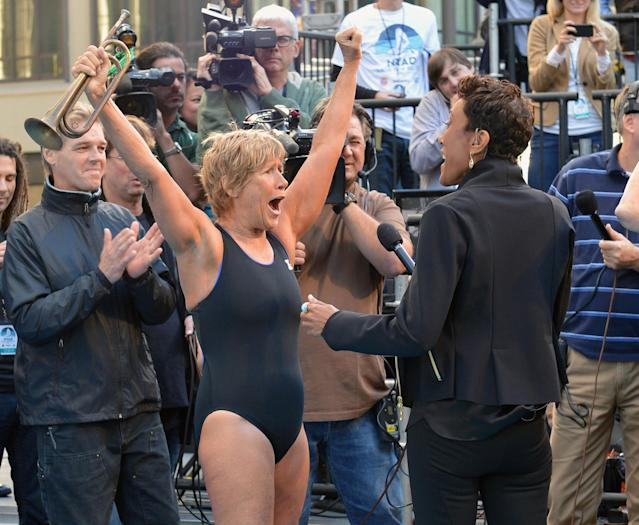 "NEW YORK, NY - OCTOBER 08: Long-distance swim legend Diana Nyad (L), fresh off her record-braking swim from Cuba to Florida and ABC's ""Good Morning America"" anchor Robin Roberts attend day 1 of ""Swim For Relief"" Benefiting Hurricane Sandy Recovery at Herald Square on October 8, 2013 in New York City. (Photo by Slaven Vlasic/Getty Images)"