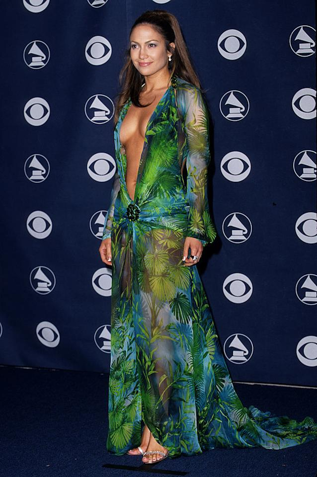 <p>In the tropical Versace dress that sealed her spot in fashion pop culture. <i>(Photo by S. Granitz/WireImage)<br /></i></p>
