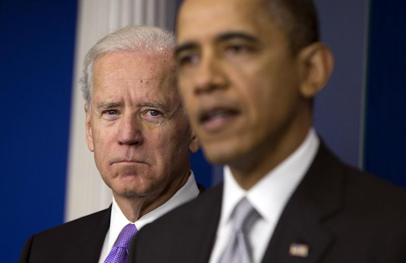 Vice President Joe Biden, left, listens as President Barack Obama announces that Biden will lead an administration-wide effort to curb gun violence in response to the Connecticut school shooting, during a news conference in the briefing room of the White House on Wednesday, Dec. 19, 2012 in Washington.  (AP Photo/ Evan Vucci)