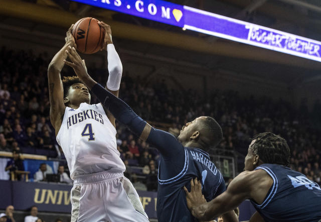 Washington forward Jaden McDaniels (4) shoots over San Diego guard Braun Hartfield (1) during the first half of an NCAA college basketball game, Sunday, Nov. 24, 2019, in Seattle. (Joshua Bessex/The News Tribune via AP)