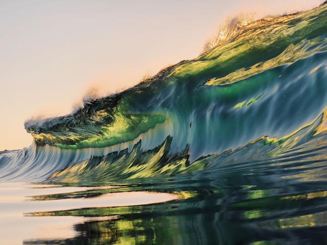 "<p>""I am obsessed with photographing waves when there is interesting light, such as on sunrise or sunset — I love the light that leaks through the waves."" (Photo: Ryan Pernofski/Caters News) </p>"