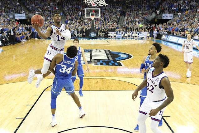 Wendell Carter was called for a block on this play in overtime of the Elite Eight game between Duke and Kansas. (Getty)