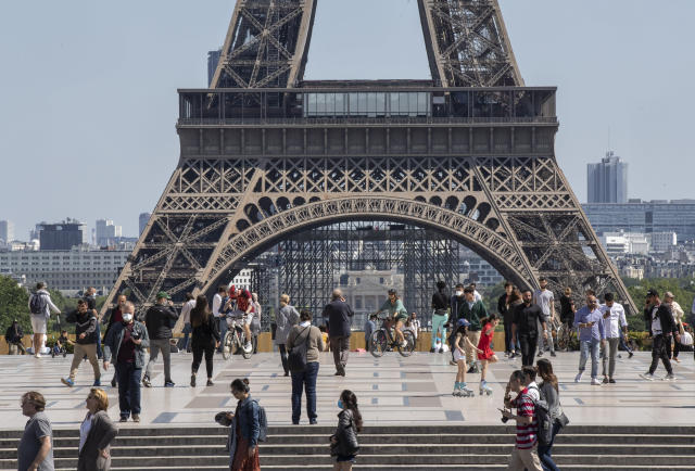 People stroll at Trocadero square next to the Eiffel Tower in Paris, France. (Michel Euler/AP)