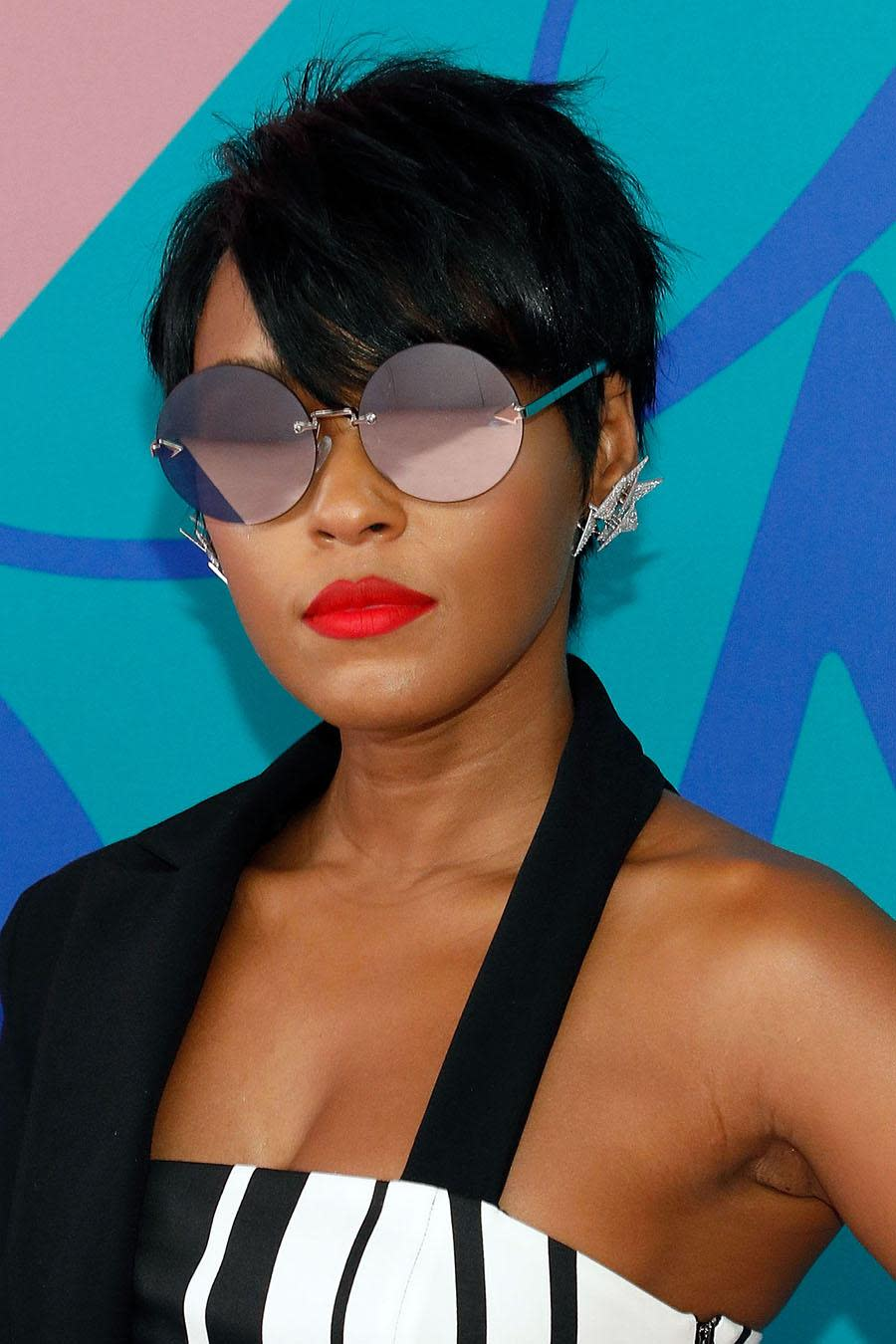 <p>At the 2017 CFDA Fashion Awards, Janelle Monae stole the scene with trendy sunglasses and her short tousled pixie cut. (Photo: Taylor Hill/FilmMagic) </p>