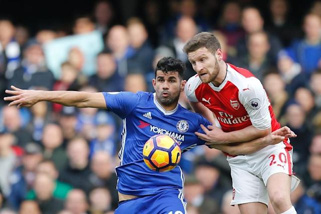 Chelsea's Diego Costa (left) and Arsenal's Shkodran Mustafi in action during the English Premier League football match between Chelsea and Arsenal at Stamford Bridge, on February 4, 2017 (AFP Photo/Ian KINGTON)
