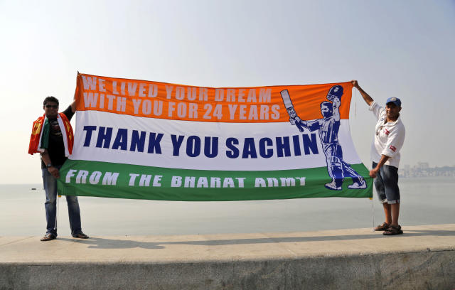Fans of Indian cricket player Sachin Tendulkar hold a banner after his last international match at Wankhede Stadium in Mumbai, India, Saturday, Nov. 16, 2013. Tendulkar's last day featured a cameo appearance bowling for a couple of overs, and a guard of honor from teammates as he walked from the field for the last time. Among his other prominent milestones include becoming the first man to score a double-century in limited-overs internationals (200 not out vs South Africa at Gwalior in 2010) and the first to reach 100 international centuries. (AP Photo/Rajanish Kakade)
