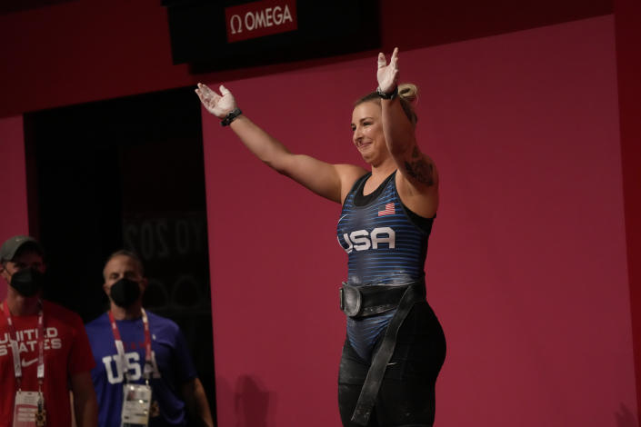 Katherine Elizabeth Nye of the United States reacts after her final lift in the women's 76kg weightlifting event, at the 2020 Summer Olympics, Sunday, Aug. 1, 2021, in Tokyo, Japan. (AP Photo/Luca Bruno)