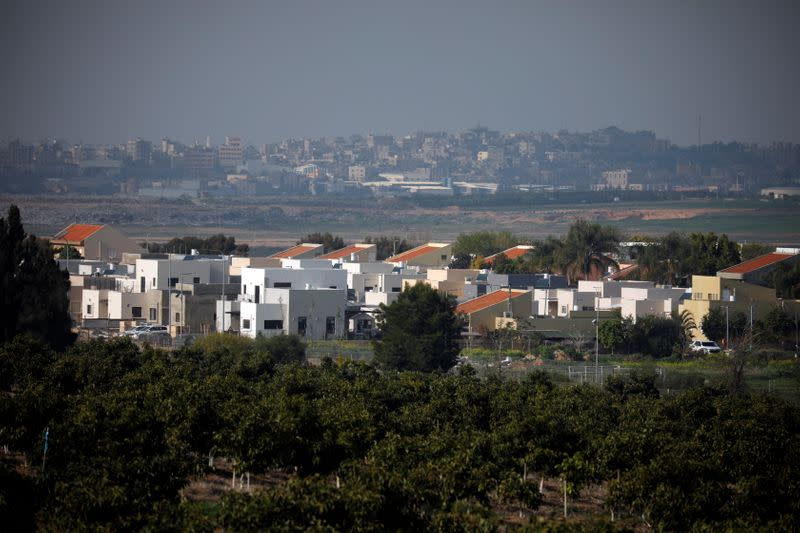 A general view shows an Israeli village in the foreground and part of the Gaza Strip, as it is seen from the Israeli side of the Israel- Gaza border