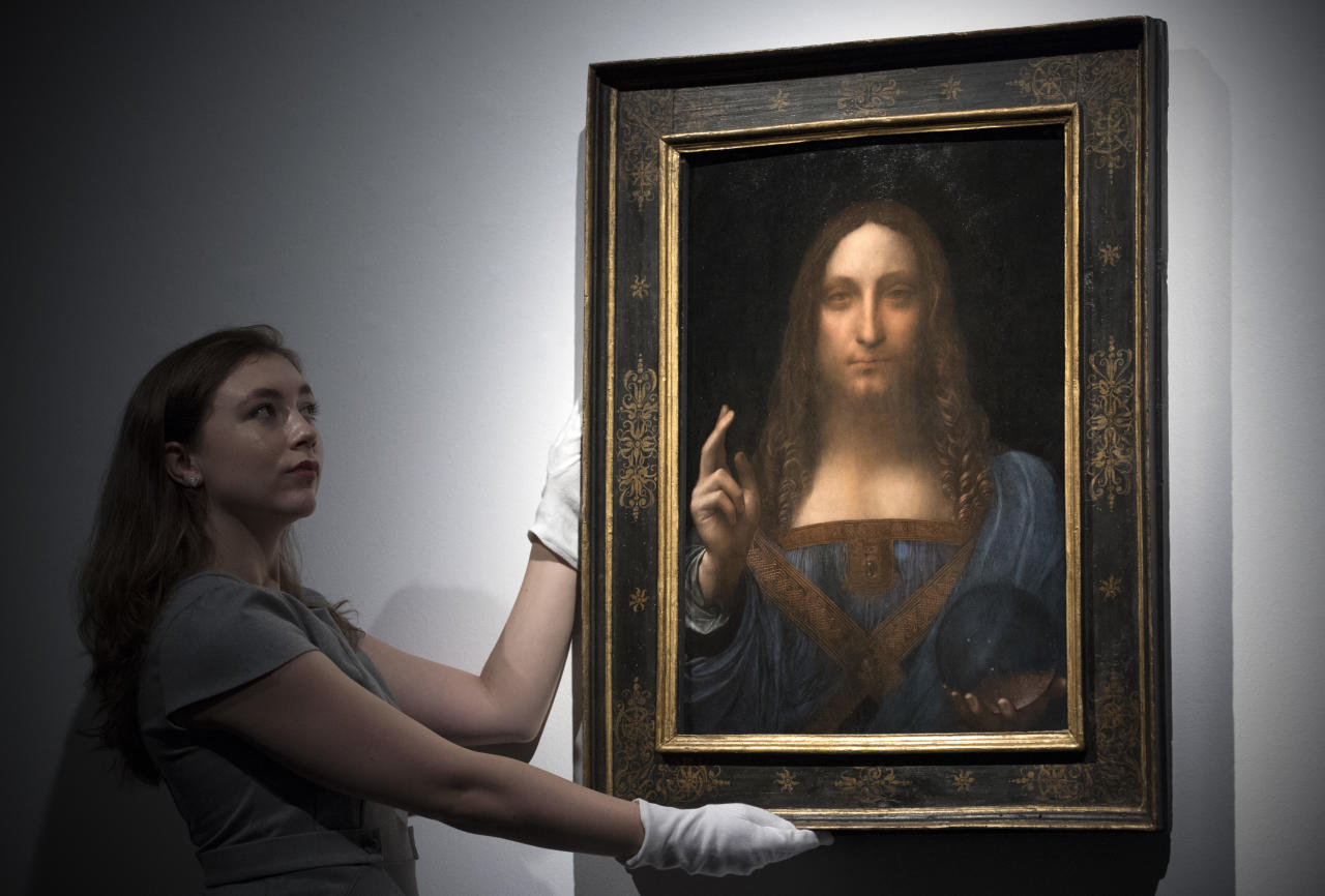 <p>1: Salvator Mundi (Saviour of the World) – by Leonardo da Vinci (circa 1505). Sold for: £341m. It shows Christ with one hand raised, the other holding a glass sphere.(Carl Court/Getty Images) </p>