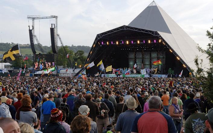 Thousands gather at Glastonbury Festival in 2019. This year's event was cancelled because of the Covid-19 outbreak, and next year's festival looks set to go a similar way - Tabatha Fireman/Redferns