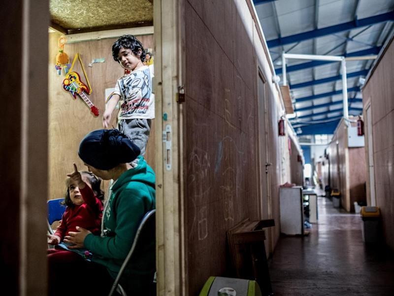 Rosa Hamy, 28, and her children, two year-old Arin and Mohammad, six, from Al Raqqa, Syria, in their unit at the Sinatex Kavalri refugee camp near Thessaloniki, Greece (Unicef)