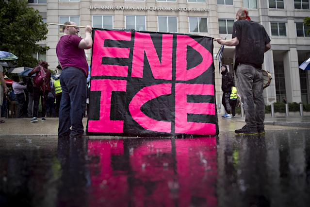 Demonstrators protest detaining and separating immigrant families outside the Immigration and Customs Enforcement (ICE) headquarters in Washington, D.C., on June 27. (Photo: Andrew Harrer/Bloomberg via Getty Images)