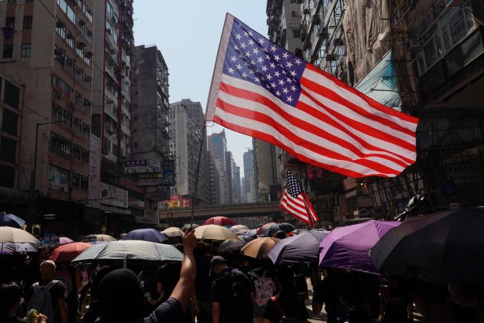 Anti-government protesters waving U.S. flags march in Hong Kong, Oct. 1, 2019. (Photo: Vincent Yu/AP)