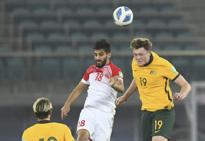 Australia's Harry Souttar, left, and Jordan's Mousa Mohammad Suleiman jump for the during the World Cup 2022 Group B qualifying soccer match between Jordan and Australia in Kuwait City, Kuwait, Tuesday, June 15, 2021. (AP Photo/Jaber Abdulkhaleg)