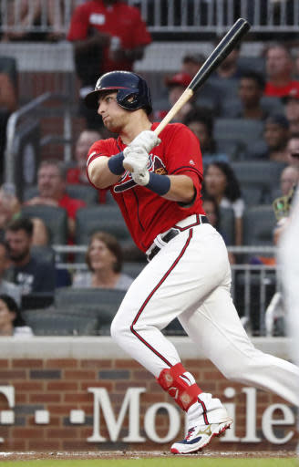 Atlanta Braves' Austin Riley drives in a run with a double in the fourth inning of a baseball game against the Washington Nationals, Friday, July 19, 2019, in Atlanta. (AP Photo/John Bazemore)