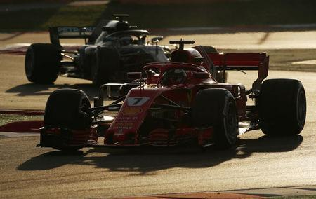 FILE PHOTO: Motor Racing - F1 Formula One - Formula One Test Session - Circuit de Barcelona-Catalunya, Montmelo, Spain - March 9, 2018. Kimi Raikkonen of Ferrari and Valtteri Bottas of Mercedes during testing. REUTERS/Albert Gea/File photo