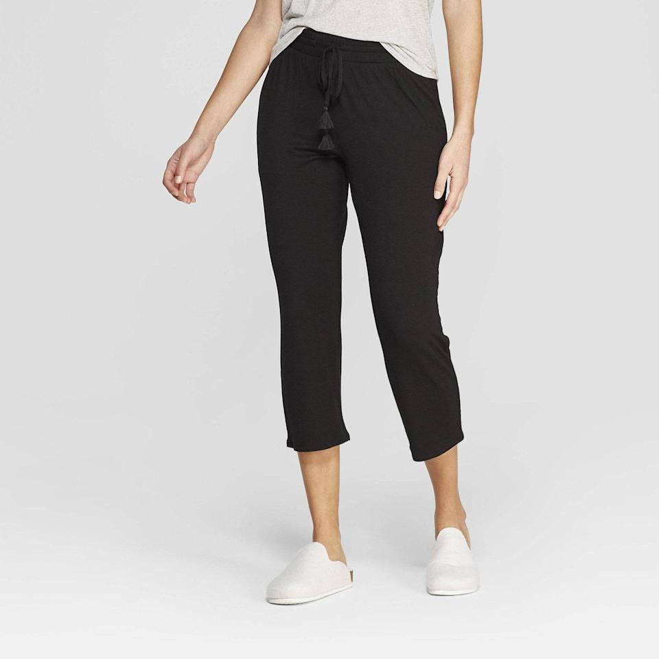 """<p>Generally speaking, you should definitely own a pair of incredibly comfy <a href=""""https://www.allure.com/gallery/best-pajamas-at-every-price-point?mbid=synd_yahoo_rss"""" rel=""""nofollow noopener"""" target=""""_blank"""" data-ylk=""""slk:pajama pants"""" class=""""link rapid-noclick-resp"""">pajama pants</a>, but for research director Lori Segal, the Stars Above Beautifully Soft Crop Pajama Pants served a bigger purpose. She originally bought a few pairs when she broke her ankle and was recuperating from surgery during the end of January. """"They were super cheap and could fit over my splint — and then my recovery flowed sadly and seamlessly into [working from home],"""" says Segal. </p> <p>Now she gets even more wear out of them, and as a bonus, they're """"surprisingly super-soft, pill-free, and durable after countless washings."""" Did we mention they also have pockets? They're available in sizes x-small to xx-large and three colors. Go on, buy them now.<br> <br> <strong>$17</strong> (<a href=""""https://shop-links.co/1705490816527932532"""" rel=""""nofollow noopener"""" target=""""_blank"""" data-ylk=""""slk:Shop Now"""" class=""""link rapid-noclick-resp"""">Shop Now</a>)</p>"""