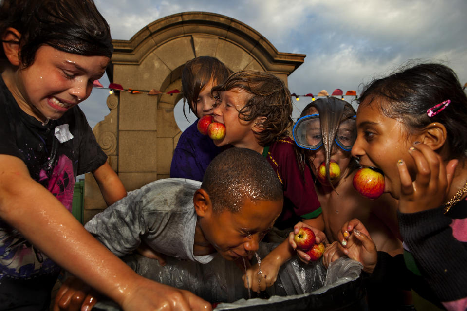 Kids bob for apples during an autumn weekend celebration in the UK. Experts say that the activity may need to be retired. (Photo by In Pictures Ltd./Corbis via Getty Images)